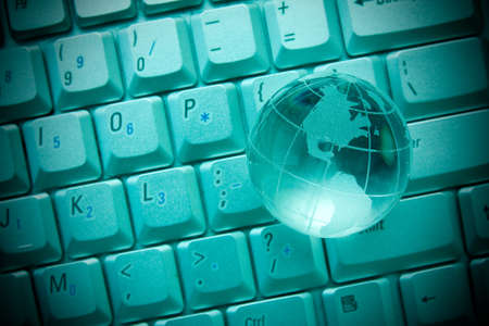 internet concept. Crystal-glass globe on keyboard of notebook  photo