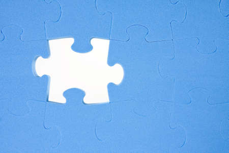 one piece missing from blue  jigsaw puzzle  photo