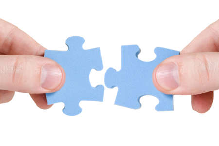 teamwork concept. two hands with different pieces of puzzle photo