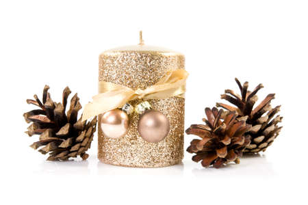 festive pine cones: Gold candle with the baubles and cones Stock Photo