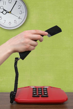 making a phone call at nine o'clock in  morning Stock Photo - 11831187