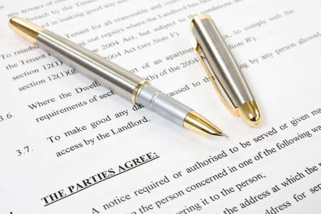tenant: ink pen with agreement between landlord and tenant