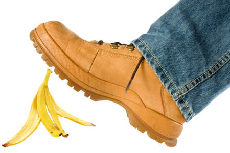 Man stepping on banana peel. isolated on white background photo