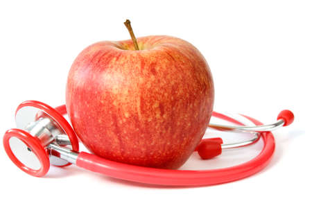 red apple and stethoscope over a white background photo