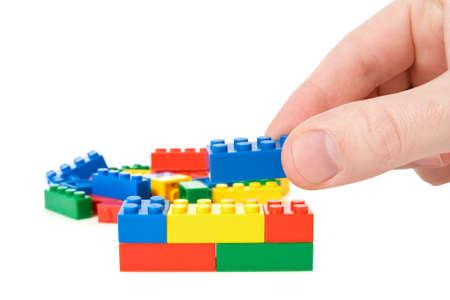 plastic bricks: hand build a color plastic  bricks. isolated on white.