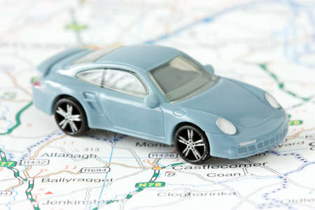 toy car:  trip planning and travel. small car on map background