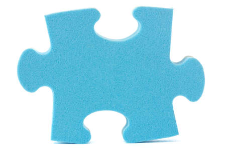 one piece:  blue puzzle piece over a white background Stock Photo