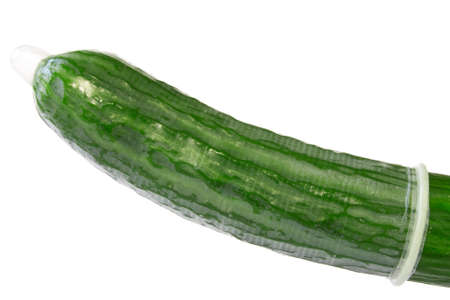 Safe sex concept. Cucumber in a condom isolated on white background. Stock Photo - 12683601
