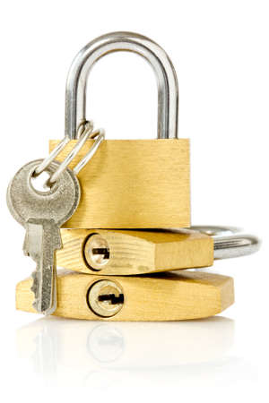 three golden padlocks over a white background photo