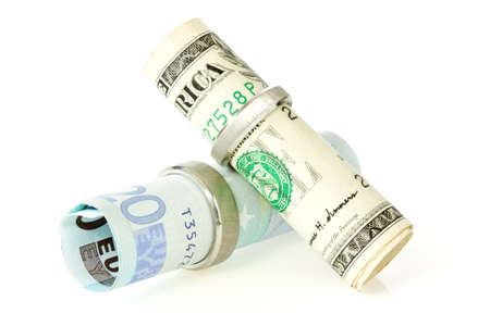 dollar and euros with a  wedding rings Stock Photo - 13544338
