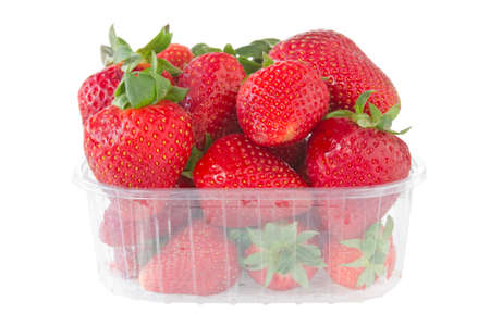 punnet of strawberries isolated on white background  photo