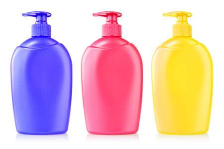 jabon liquido: tres botellas de plástico de colores con jabón líquido