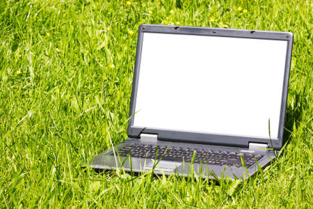 laptop with blank screen on the grass photo