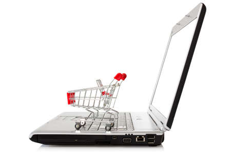 laptop with shopping cart over a white background Stock Photo - 14085840