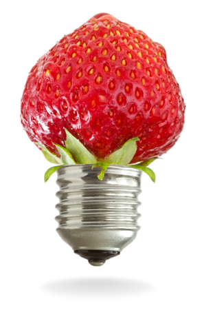 light bulb with red strawberry on white background photo