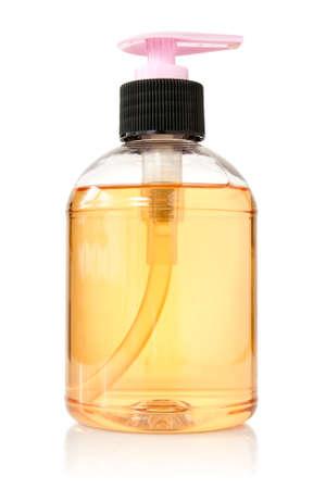 jabon liquido: botella transparente con agua y jabón líquido en el fondo blanco Foto de archivo