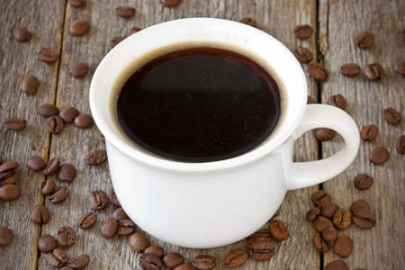 coffeebeans: cup of coffee and coffee-beans  on wood background Stock Photo
