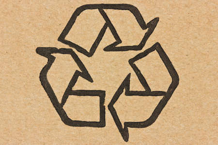recycle symbol printed on a recycled cardboard  photo