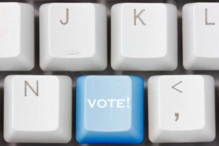 encuestando: concepto elecci�n con la tecla voto mostrando votaci�n o votar Foto de archivo