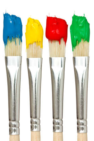 Four paintbrushes with color paints. Isolated on white background. photo