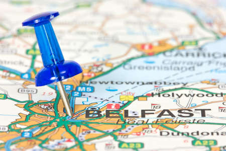 Pushpin pointing  location of Belfast on the map Stock Photo
