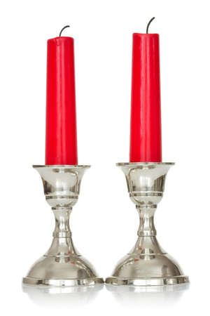 silver plated: silver plated candlesticks with red candles on white background