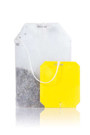 Teabag with yellow label. Isolated on white background  Stock Photo