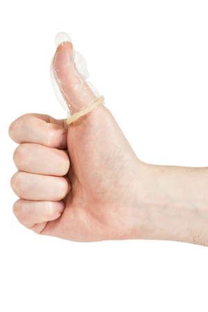 educacion sexual: Condón en el dedo, aislado en fondo blanco