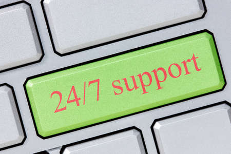 Keyboard with green 247 support button, business concept photo