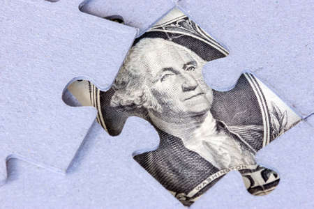 investment metaphor money: Jigsaw puzzle with Washington looking to you
