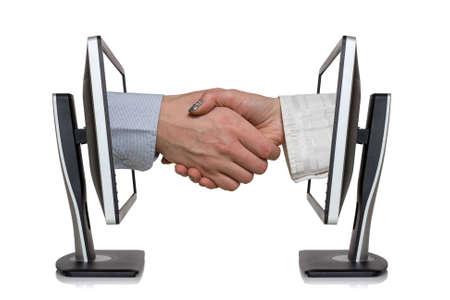 Twee beeldschermen en handen in handshaking, internet werkconcept, draadloze communicatie, on-line business Stockfoto