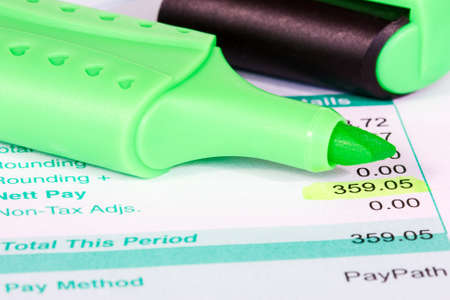 Payslip with monthly wage and green marker Stock Photo - 18409999