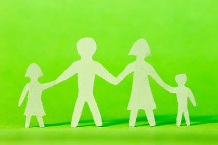Family cutout shape isolated against a green background  photo