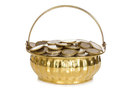 Golden pot full of coins. Isolated on white background photo