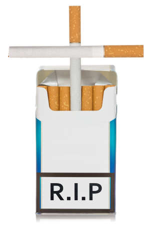 Cigarettes package made as grave, isolated on white background photo