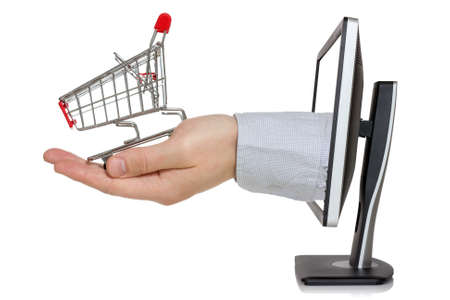 E-commerce conception  Computer monitor and hand with shopping cart
