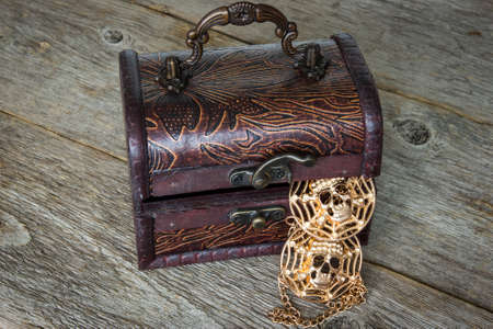 Wooden chest with a pirates gold inside photo