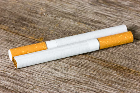 Two cigarettes on the old wooden floor