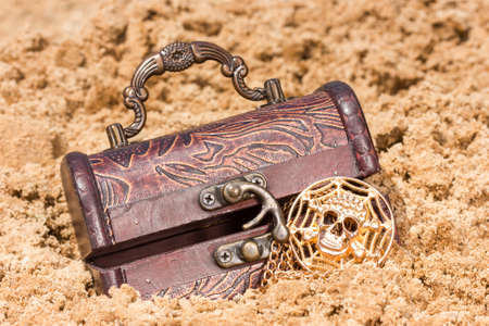 Pirate treasure chest with  the gold  on a sandy beach photo