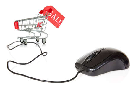 Internet sales concept. Computer mouse connected to the shopping cart. photo