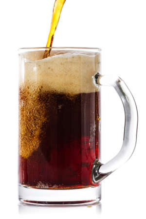 dark beer: Dark beer pouring into glass. Isolated on white background.