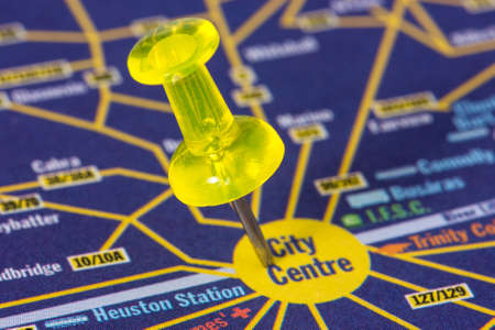 Yellow pushpin on the map showing city center location photo