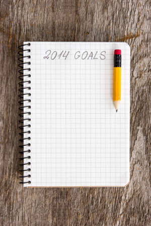 Notebook with pencil and goals of year 2014 photo