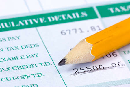 Yellow pencil and report with monthly wage Stock Photo - 22108379