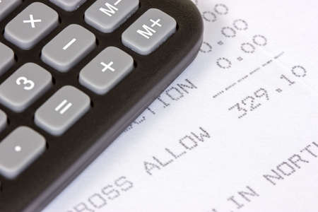 Black calculator with the printed receipt of  allowance Stock Photo - 22108380