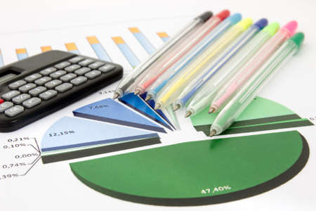 Business chart with a calculator and pile of colored pens Stock Photo - 22546832