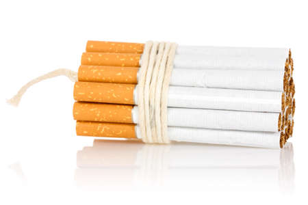 Stop smoking concept. Cigarettes tied with rope and wick isolated on white