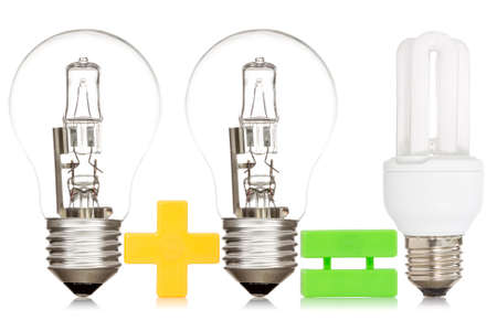Comparison between a light bulbs, isolated on white background photo