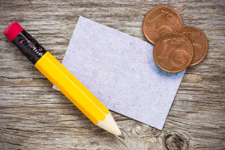 copper coin: Copper euro cents with pencil and  paper card