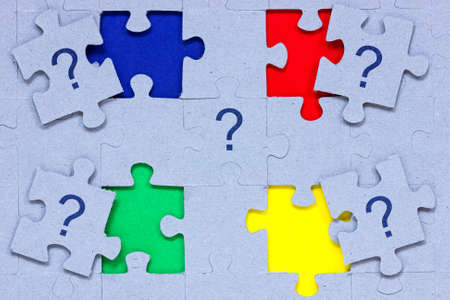 Problem solving concept. Puzzle  with question marks on it. photo